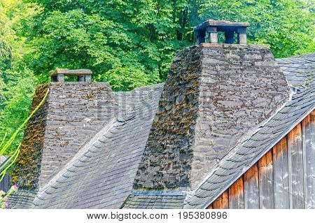 Old Double chimney made of natural stone