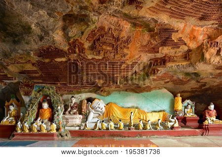 Reclining Buddha Statue Inside Kawgun Cave In Hpa-an, Myanmar (burma).