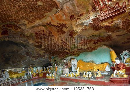 Beautiful View Inside Kawgun Cave In Hpa-an, Myanmar. A Lot Of Various Buddha Statues And Ancient St