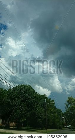 grayish storm clouds above the trees.and the city