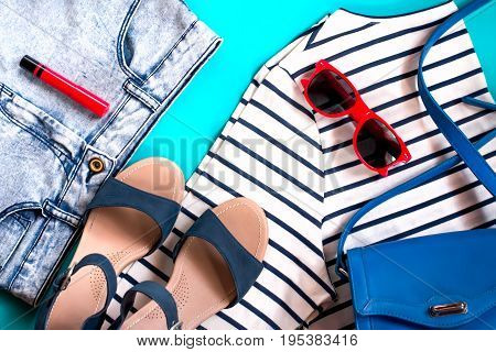 Female casual clothes - marine t-shirt, denim shorts, sandals, sunglasses