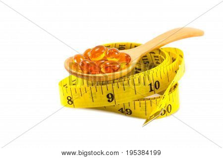 omega 3 fish oil capsules with measuring tape on isolated background