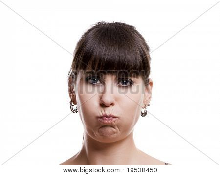 Close-up portrait of a lovely woman with a upset expression against white background
