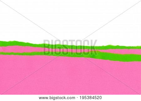 Pink and green strips of paper with the ragged edge
