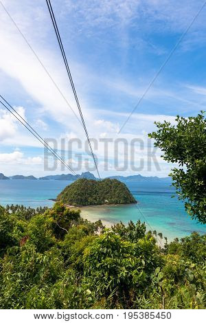 EL NIDO PALAWAN PHILIPPINES - JANUARY 18 2017: Vertical picture of zipline of Las Cabanas Beach with a great view of the bay rocks and trees.