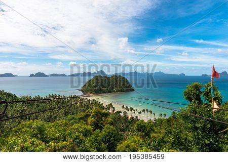 EL NIDO PALAWAN PHILIPPINES - JANUARY 18 2017: Wide angle view of the fantastic zipline of Las Cabanas Beach with a great view of the bay rocks and trees.