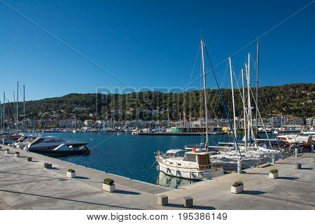 Horizontal view of Boats and marina in Estartit city on the Costa Brava under blue sky