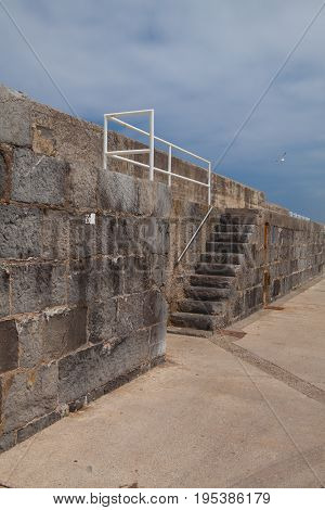 Detail of very long and high pier in Castro Urdiales Cantabria Spain