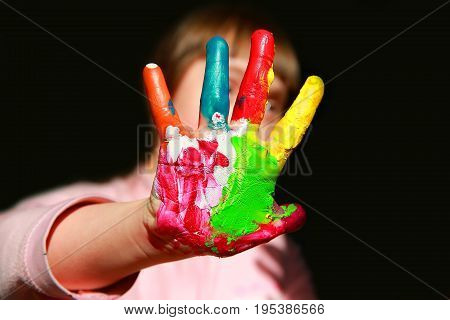 Cute little kid with painted hands .