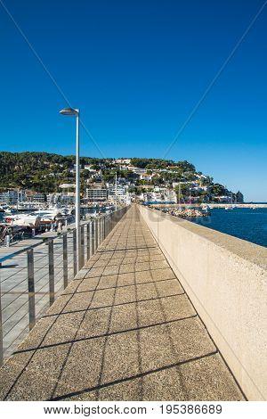 Walk at L'Estartit port on a sunny day