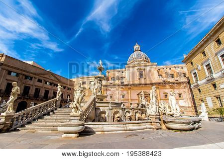 the Praetoria Fountain with the dome of Santa Caterina in the background in the square of Shame Palermo Italy