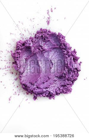 Crushed purple eye shadow isolated on the white background