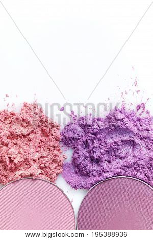 Crushed eye shadow and round eye shadow isolated on the white background
