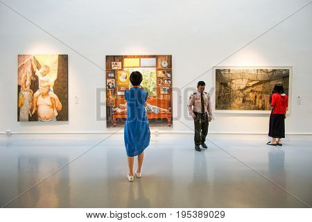 Bangkok Art and Culture Centre, Bangkok, Thailand - July 9, 2017: Inside the art gallery, people pay attention to art exhibitions.