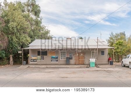 KANONEILAND SOUTH AFRICA - JUNE 12 2017: A gas station and liquor store in Kanoneiland a village on an island in the Orange River near Upington in the Northern Cape Province