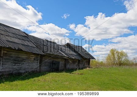 Old dilapidated wooden house on a bright sunny day