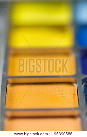 pallet of colored eye shadows, the texture. Shallow depth of field