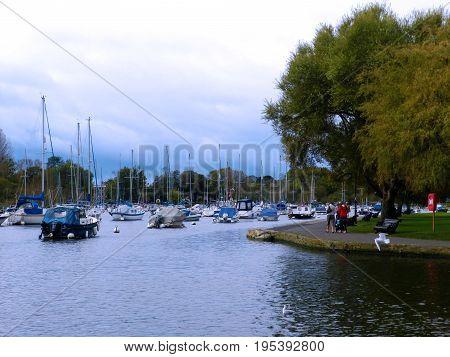 Boats moored at Christchurch Quay Dorset England UK