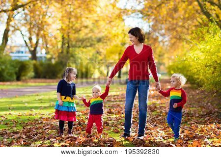 Mother And Kids In Autumn Park