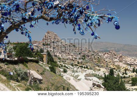 Uchisar Castle And Evil Eye Beads Tree In Cappadocia