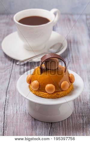Cake from mousse and caramel with coffee. Vertically