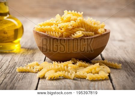 Rotini pasta in wooden bowl, close up