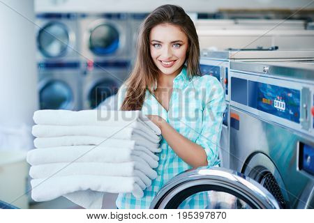 Woman With A Heap Of Linen