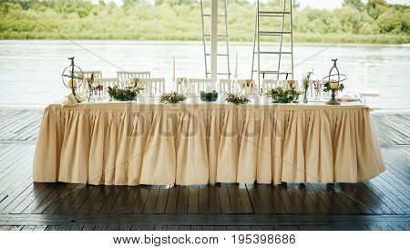 Completely Decorated Wedding Party Table For The Newlyweds Bride