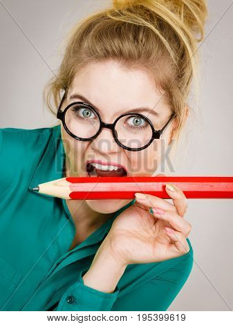 Business Woman Biting Pencil