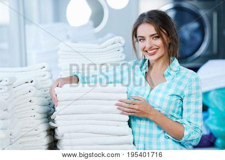 Woman Near Heaps Of White Clean Linen