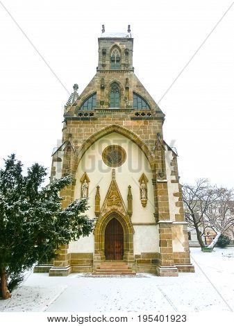 Kosice, Slovakia - January 05, 2016: St. Michael chapel in the main square of Kosice city in eastern Slovakia at snow day