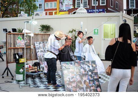 Khonkean Thailand - April 2 2017 : Open-air barber at Ton tan market Khonkean Thailand