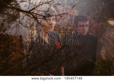 Portrait of vintage men and women through glass