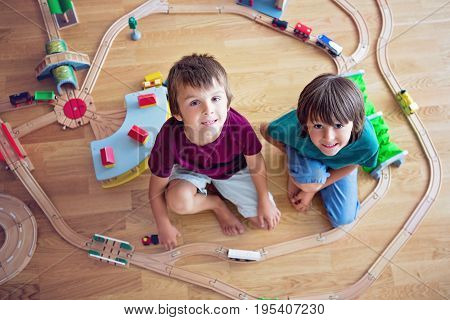 Sweet Preschool Children, Boy Brothers, Playing With Wooden Railway And Trains At Home