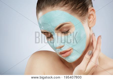 Pretty Girl Doing Cosmetic Face Mask