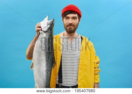 Delightful Young Bearded Man Going Fishing Demonstrating His Huge Catch Rejoicing His Success. Glad