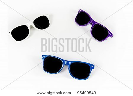 Multicolored sunglasses on white background, summer sunglasses