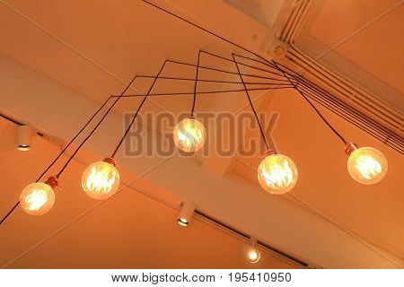 Decoration antique edison led light style filament light bulbs graphic of wire background and copyspace Thailand