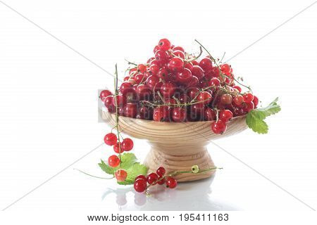 Ripe Red Currant In A Wooden Vase