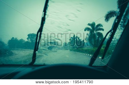 Water drop on glass mirror. Wiper on a wet windshield nature background.