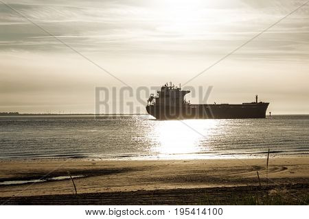 A freight ship photographed from the beach