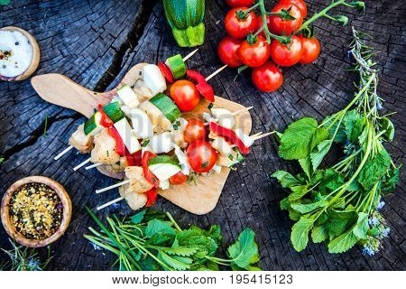 BBQ barbecue ingredients. Marinated BBQ meat. Marinated grill chicken and kebab. Vegetables and meat for barbecue