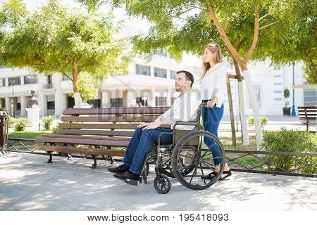 Man In A Wheelchair With His Girlfriend