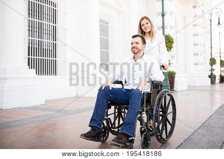 Woman Pushing Her Boyfriend's Wheelchair