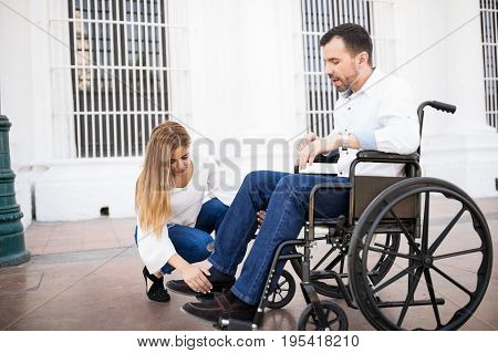 Man In Wheelchair Getting Some Help