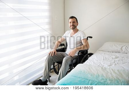 Paralyzed Man On A Wheelchair At Home