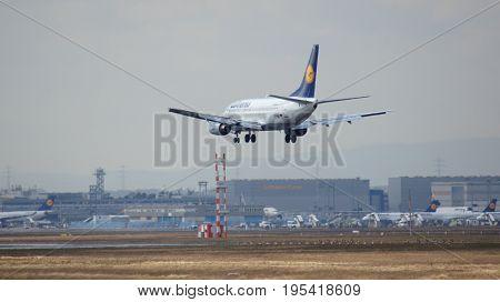 FRANKFURT, GERMANY - FEB 28th, 2015: Lufthansa Boeing 737-530, MSN 24824, Registration D-ABIL landing on a runway at Frankfurt International Airport FRA in the warm light of the setting sun
