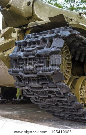 Tank Caterpillar Track with Wheels. The photo shows the tracks of a tank from the period of the Second World War.