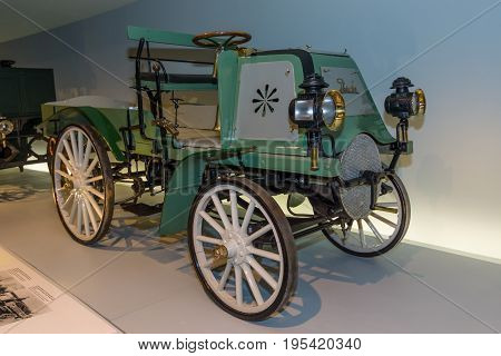 STUTTGART GERMANY- MARCH 19 2016: Vintage car Daimler Motor-Geschaeftswagen (Daimler motorized business vehile) 1899. Mercedes-Benz Museum.