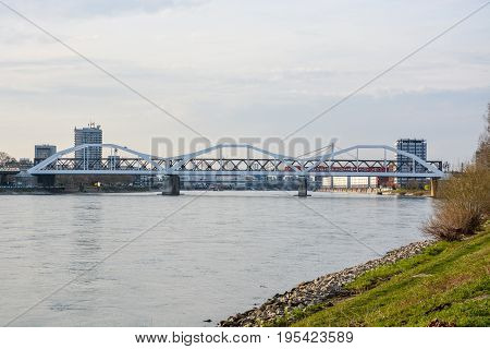 The white bridge from Mannheim to Ludwigshafen over the river Rhein with a train on it